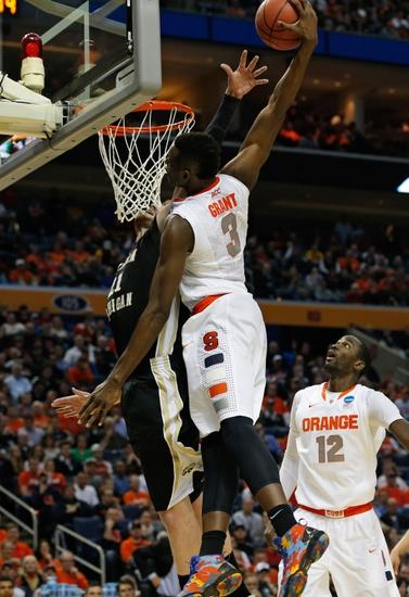 Mar 20, 2014; Buffalo, NY, USA; Syracuse Orange forward Jerami Grant (3) and Western Michigan Broncos center Shayne Whittington (21) during the game in the second round of the 2014 NCAA Tournament at First Niagara Center. Mandatory Credit: Kevin Hoffman-USA TODAY Sports