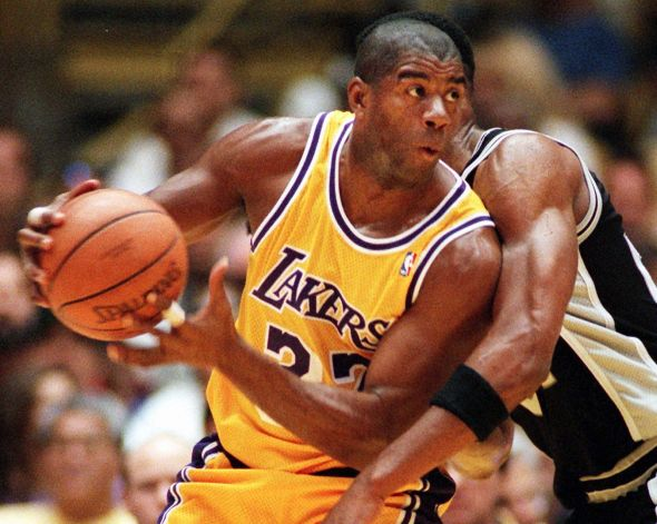 Magic Johnson won three MVP awards while leading the Lakers to five titles in the 1980s. (US PRESSWIRE)