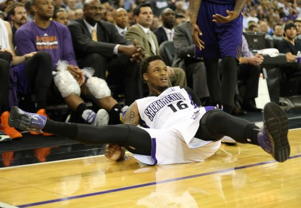 Apr 16, 2014; Sacramento, CA, USA; Sacramento Kings guard Ben McLemore (16) on the ground after being fouled on a three point shot against the Phoenix Suns during the fourth quarter at Sleep Train Arena. The Phoenix Suns defeated the Sacramento Kings 104-99. Mandatory Credit: Kelley L Cox-USA TODAY Sports