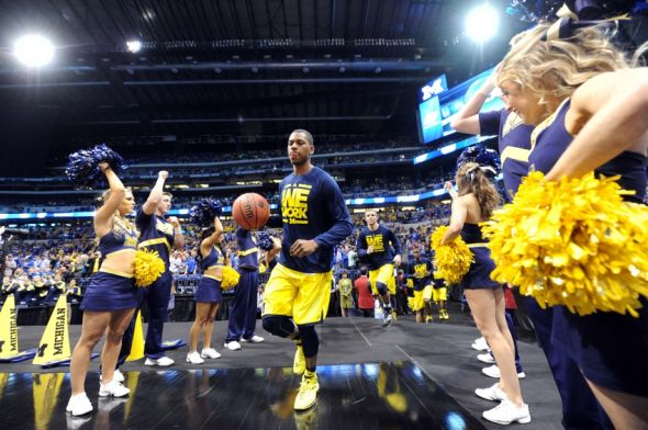 Mar 30, 2014; Indianapolis, IN, USA; Michigan Wolverines forward Glenn Robinson III takes the court before the finals of the midwest regional of the 2014 NCAA Mens Basketball Championship tournament against the Kentucky Wildcats at Lucas Oil Stadium. Mandatory Credit: Thomas J. Russo-USA TODAY Sports