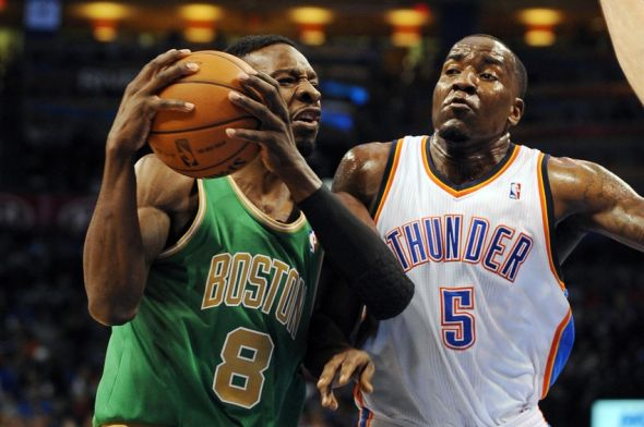Mar 10, 2013; Oklahoma City, OK, USA; Boston Celtics forward Jeff Green (8) handles the ball against Oklahoma City Thunder center Kendrick Perkins (5) during the first half at Chesapeake Energy Arena. Mandatory Credit: Mark D. Smith-USA TODAY Sports
