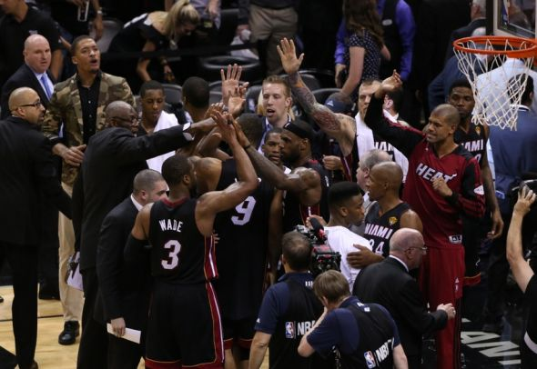 Jun 8, 2014; San Antonio, TX, USA; Miami Heat forward LeBron James (6) and teammates celebrate a victory against the San Antonio Spurs in game two of the 2014 NBA Finals at AT&T Center. The Heat beat the Spurs 98-96. Mandatory Credit: Soobum Im-USA TODAY Sports
