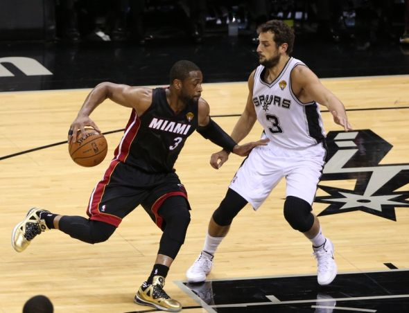 Jun 8, 2014; San Antonio, TX, USA; Miami Heat guard Dwyane Wade (3) drives against San Antonio Spurs guard Marco Belinelli (3) in game two of the 2014 NBA Finals at AT&T Center. Mandatory Credit: Soobum Im-USA TODAY Sports