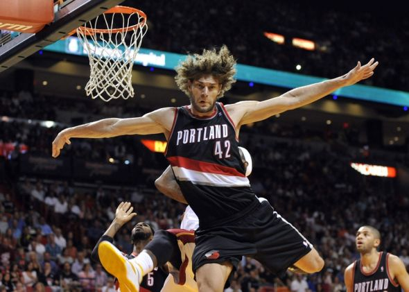 Mar 24, 2014; Miami, FL, USA; Portland Trail Blazers center Robin Lopez (42) fouls Miami Heat forward LeBron James (6) during the second half at American Airlines Arena. Miami won 93-91. Mandatory Credit: Steve Mitchell-USA TODAY Sports