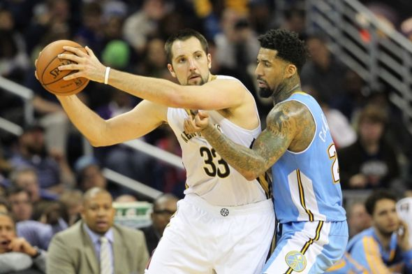 Dec 27, 2013; New Orleans, LA, USA; New Orleans Pelicans power forward Ryan Anderson (33) is defended by Denver Nuggets small forward Wilson Chandler (21) in the second half against the New Orleans Pelicans at the New Orleans Arena. New Orleans defeated Denver 105-89. Mandatory Credit: Crystal LoGiudice-USA TODAY Sports