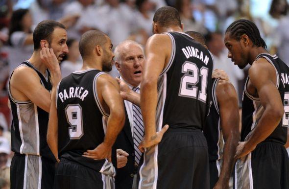 Jun 20, 2013; Miami, FL, USA; San Antonio Spurs head coach Gregg Popovich talks with San Antonio Spurs power forward Tim Duncan (21), point guard Tony Parker (9), and shooting guard Manu Ginobili (left) during the fourth quarter of game seven in the 2013 NBA Finals at American Airlines Arena. Mandatory Credit: Steve Mitchell-USA TODAY Sports