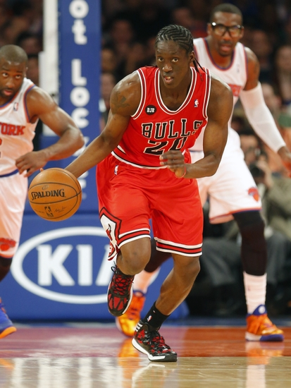 Apr 13, 2014; New York, NY, USA; Chicago Bulls guard Tony Snell (20) brings the ball up court during the first half against the New York Knicks at Madison Square Garden. Mandatory Credit: Jim O