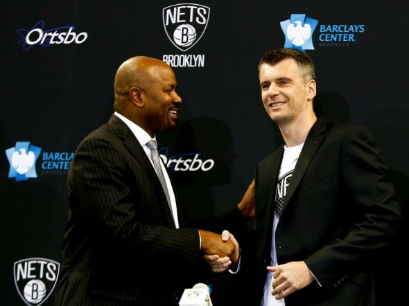 Jul 18, 2013; Brooklyn, NY, USA; Brooklyn Nets general manager Billy King (left) shakes hands with owner Mikhail Prokhorov during a press conference to introduce the newest members of the Brooklyn Nets at Barclays Center. Mandatory Credit: Debby Wong-USA TODAY Sports