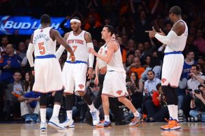 Apr 2, 2014; New York, NY, USA; New York Knicks forward Carmelo Anthony (7) celebrates a basket with teammates against the Brooklyn Nets during the first half at Madison Square Garden. Mandatory Credit: Joe Camporeale-USA TODAY Sports