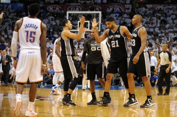 May 31, 2014; Oklahoma City, OK, USA; San Antonio Spurs forward Tim Duncan (21) , guard Danny Green (4) and forward Boris Diaw (33) celebrate after a play against the Oklahoma City Thunder in the second half in game six of the Western Conference Finals of the 2014 NBA Playoffs at Chesapeake Energy Arena. Mandatory Credit: Mark D. Smith-USA TODAY Sports