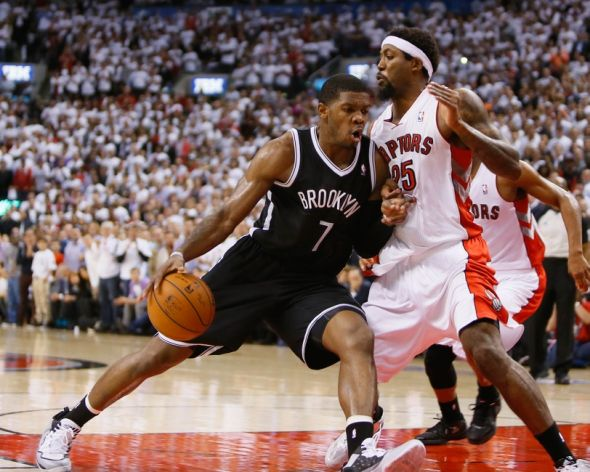 Apr 30, 2014; Toronto, Ontario, CAN; Brooklyn Nets guard Joe Johnson (7) drives to the net against Toronto Raptors guard-forward John Salmons (25) in game five of the first round of the 2014 NBA Playoffs at the Air Canada Centre. Toronto defeated Brooklyn 115-113. Mandatory Credit: John E. Sokolowski-USA TODAY Sports