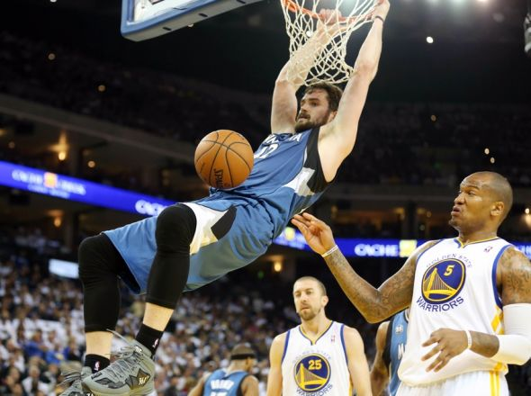 Apr 14, 2014; Oakland, CA, USA; Minnesota Timberwolves forward Kevin Love (42) dunks against the Golden State Warriors during the first quarter at Oracle Arena. Mandatory Credit: Kelley L Cox-USA TODAY Sports