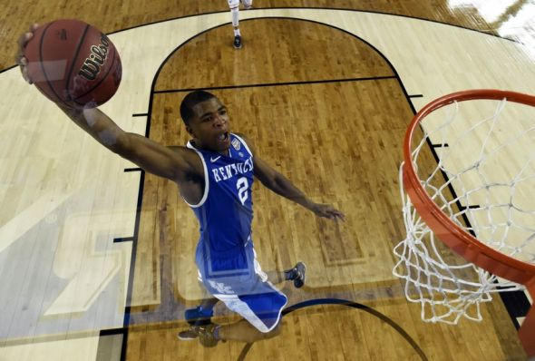 Apr 7, 2014; Arlington, TX, USA; Kentucky Wildcats guard Aaron Harrison (2) dunks the ball during the first half against against the Connecticut Huskies during the championship game of the Final Four in the 2014 NCAA Mens Division I Championship tournament at AT&T Stadium. Mandatory Credit: Pool Photo-USA TODAY Sports