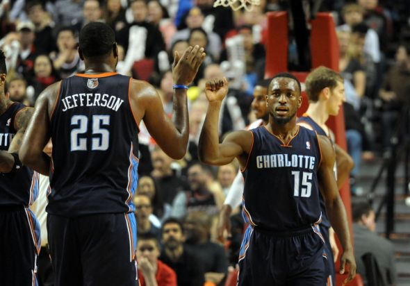 Charlotte Hornets' Guard Kemba Walker and Charlotte Hornets' Center Al Jefferson