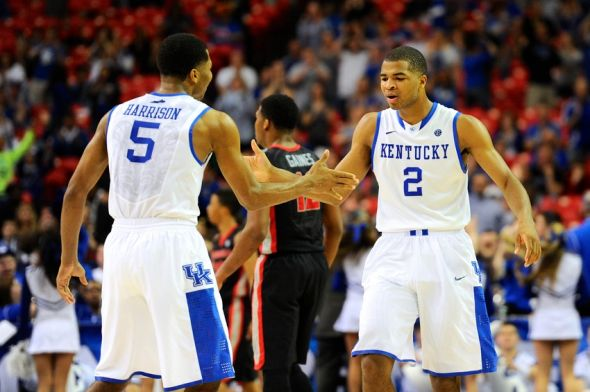Mar 15, 2014; Atlanta, GA, USA; Kentucky Wildcats guard Andrew Harrison (5) and guard Aaron Harrison (2) react after a basket against the Georgia Bulldogs during the second half in the semifinals of the SEC college basketball tournament at Georgia Dome. Kentucky defeated Georgia 70-58. Mandatory Credit: Dale Zanine-USA TODAY Sports