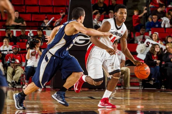 November 23, 2012; Athens, GA, USA; Georgia Bulldogs guard Charles Mann (4) dribbles past East Tennessee State Buccaneers guard Mario Stramaglia (3) in the second half at Stegeman Coliseum. Georgia won 54-38. Mandatory Credit: Daniel Shirey-USA TODAY Sports