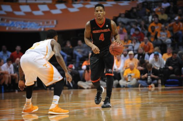 Feb 18, 2014; Knoxville, TN, USA; Georgia Bulldogs guard Charles Mann (4) brings the ball up court against the Tennessee Volunteers during the first half at Thompson-Boling Arena. Mandatory Credit: Randy Sartin-USA TODAY Sports