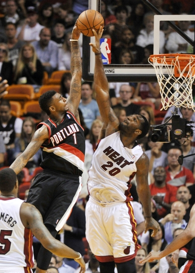 Mar 24, 2014; Miami, FL, USA; Miami Heat center Greg Oden (20) fouls Portland Trail Blazers forward Dorell Wright (1) during the second half at American Airlines Arena. Miami won 93-91. Mandatory Credit: Steve Mitchell-USA TODAY Sports