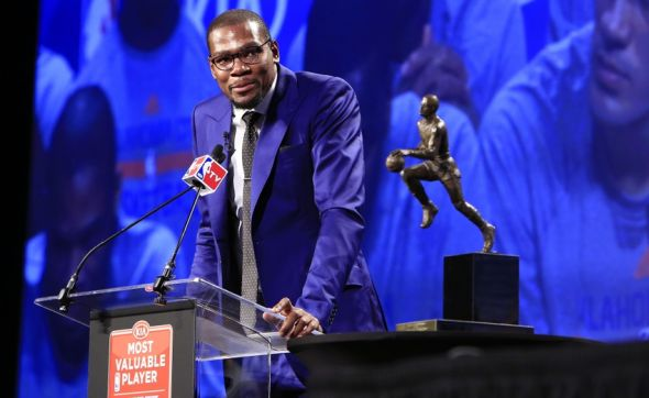 May 6, 2014; Oklahoma City, OK, USA; Oklahoma City Thunder player Kevin Durant speaks after receiving the MVP trophy at Thunder Events Center. Mandatory Credit: Alonzo Adams-USA TODAY Sports