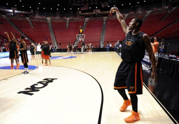 Mar 20, 2014; San Diego, CA, USA; Oklahoma State Cowboys guard Marcus Smart shoots during practice before the second round of the 2014 NCAA Tournament at Viejas Arena. Mandatory Credit: Robert Hanashiro-USA TODAY Sports