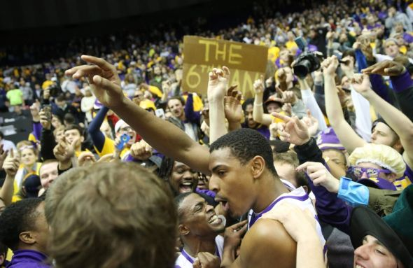 Jan 28, 2014; Baton Rouge, LA, USA; LSU Tigers forward Jordan Mickey (25) and teammates celebrate with fans at Pete Maravich Assembly Center after defeating Kentucky 87-82. Mandatory Credit: Crystal LoGiudice-USA TODAY Sports