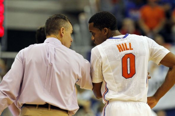 Nov 8, 2013; Gainesville, FL, USA; Florida Gators head coach Billy Donovan talks with guard Kasey Hill (0) during the second half against the North Florida Ospreys at Stephen C. O'Connell Center. Florida won 77-69. Mandatory Credit: Kim Klement-USA TODAY Sports