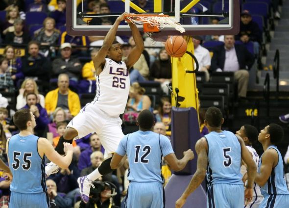 Jan 4, 2014; Baton Rouge, LA, USA; LSU Tigers forward Jordan Mickey (25) dunks the ball against the Rhode Island Rams in the second half at the Pete Maravich Assembly Center. Rhode Island defeated LSU 74-70. Mandatory Credit: Crystal LoGiudice-USA TODAY Sports
