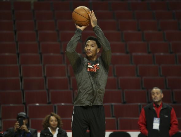 Mar 23, 2015; Chicago, IL, USA; Chicago Bulls guard Derrick Rose (1) shoots before the NBA game against the Charlotte Hornets at United Center. Mandatory Credit: Kamil Krzaczynski-USA TODAY Sports