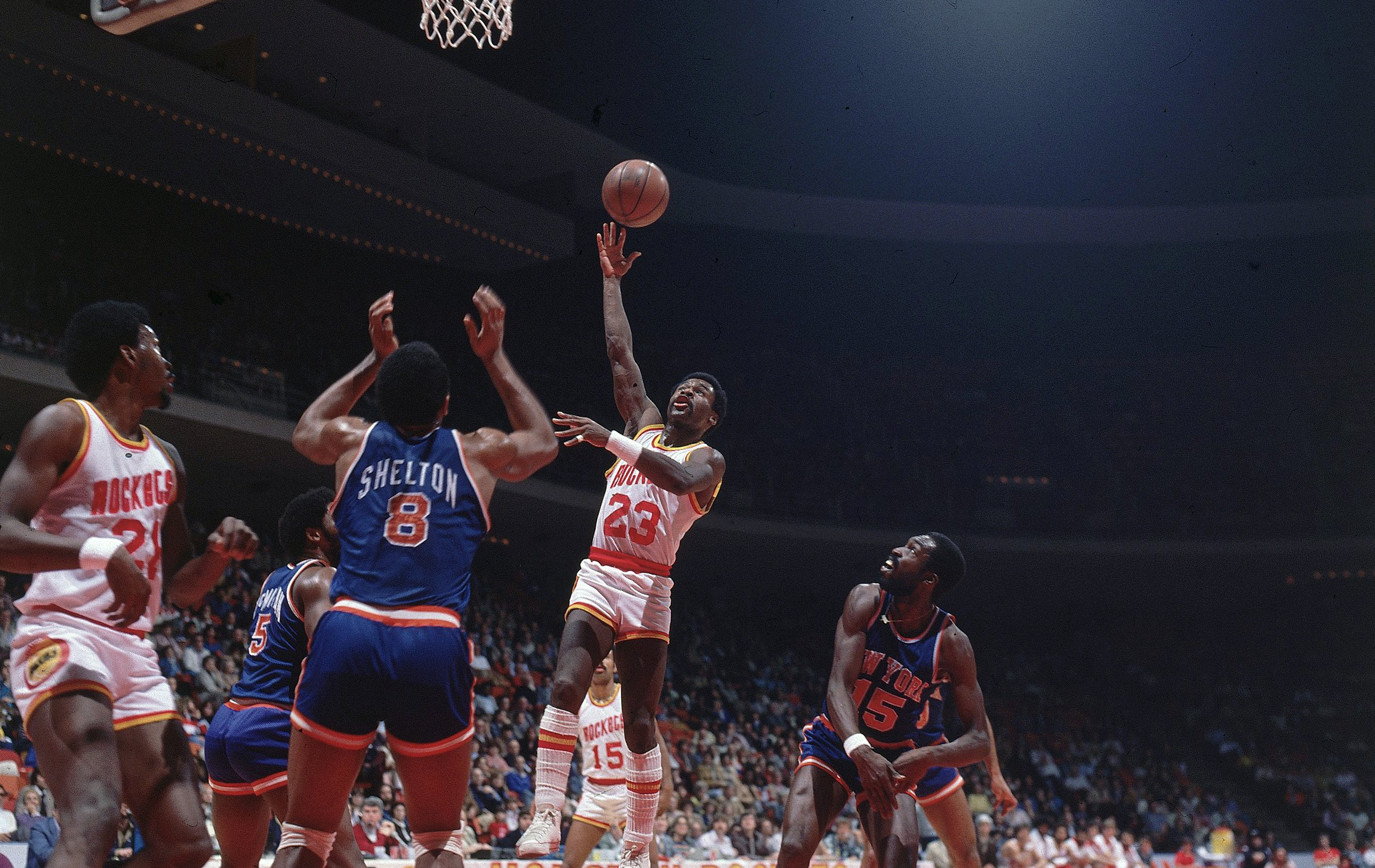 Old pictures of Moses Malone and Calvin Murphy