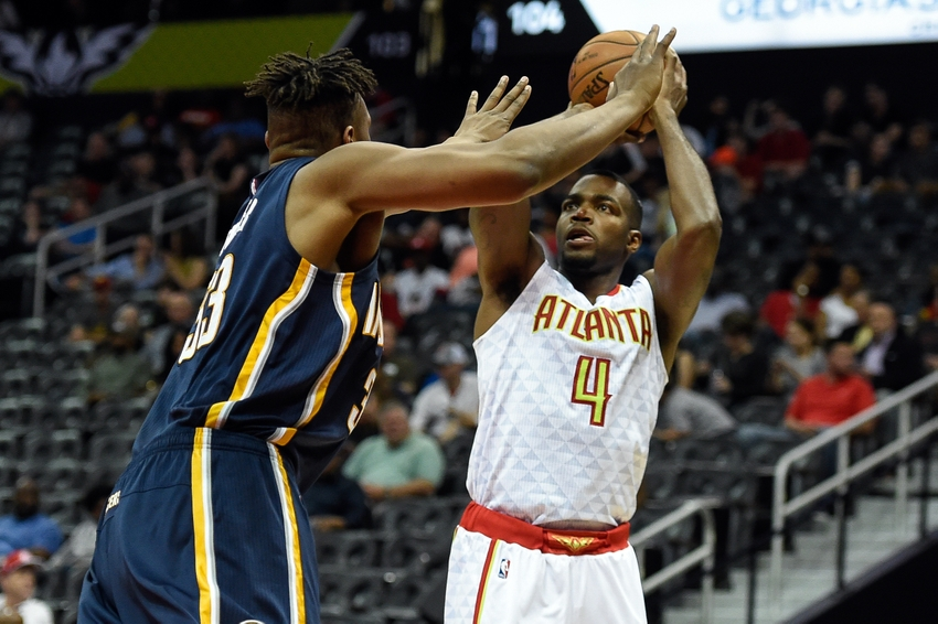 Mar 13, 2016; Atlanta, GA, USA; Atlanta Hawks forward Paul Millsap (4) shoots over Indiana Pacers forward Myles Turner (33) during the second half at Philips Arena. The Hawks defeated the Pacers 104-75. Mandatory Credit: Dale Zanine-USA TODAY Sports