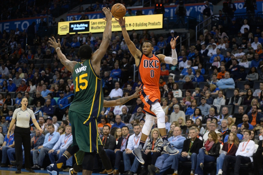 Dec 13, 2015; Oklahoma City, OK, USA; Oklahoma City Thunder guard Russell Westbrook (0) passes the ball in front of Utah Jazz forward Derrick Favors (15) during the second quarter at Chesapeake Energy Arena. Mandatory Credit: Mark D. Smith-USA TODAY Sports