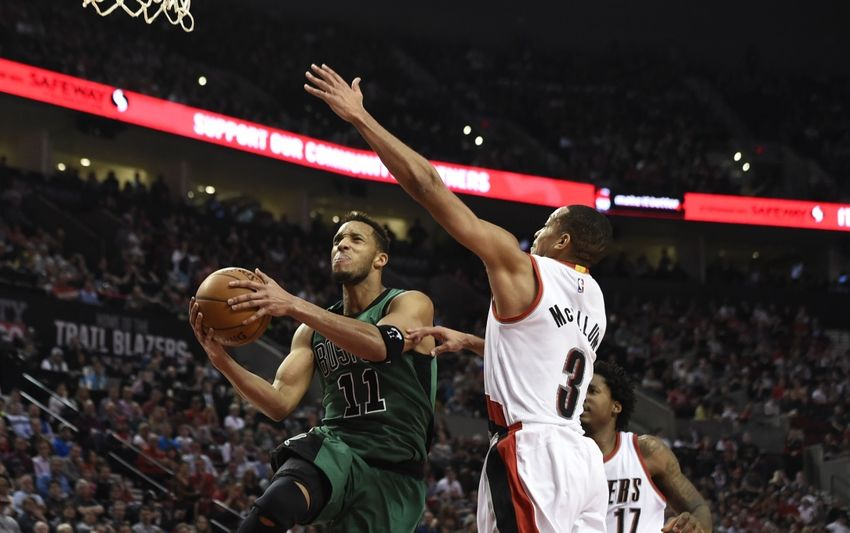 9222231-evan-turner-c.j.-mccollum-nba-boston-celtics-portland-trail-blazers-1-850x533