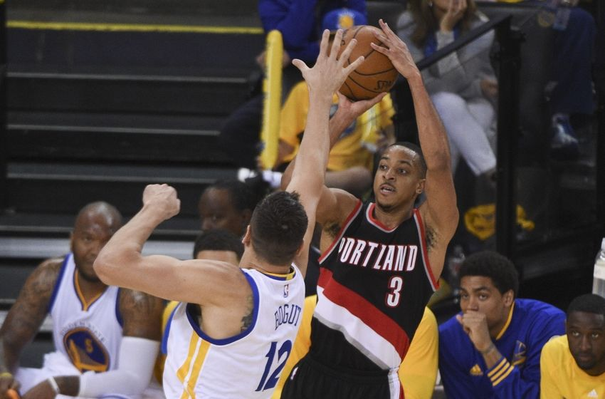 May 1, 2016; Oakland, CA, USA; Portland Trail Blazers guard C.J. McCollum (3) shoots the basketball against Golden State Warriors center Andrew Bogut (12) during the fourth quarter in game one of the second round of the NBA Playoffs at Oracle Arena. The Warriors defeated the Trail Blazers 118-106. Mandatory Credit: Kyle Terada-USA TODAY Sports