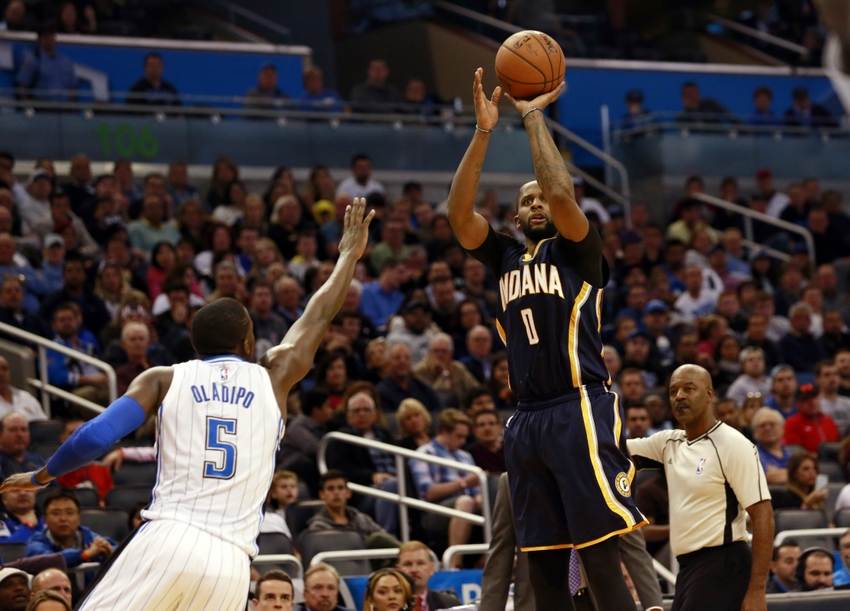Jan 6, 2016; Orlando, FL, USA; Indiana Pacers forward C.J. Miles (0) shoots a three pointer over Orlando Magic guard Victor Oladipo (5) during the second half at Amway Center. Indiana defeated Orlando 95-86. Mandatory Credit: Kim Klement-USA TODAY Sports