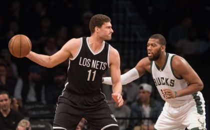 Mar 13, 2016; Brooklyn, NY, USA; Milwaukee Bucks center Greg Monroe (15) defends against Brooklyn Nets center Brook Lopez (11) in the first half at Barclays Center. Milwaukee defeats Brooklyn 109-100. Mandatory Credit: William Hauser-USA TODAY Sports