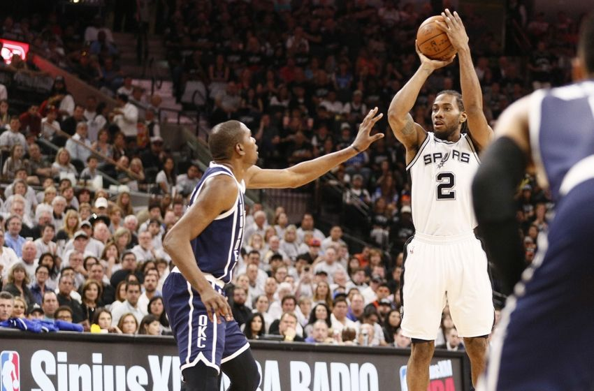 Apr 30, 2016; San Antonio, TX, USA; San Antonio Spurs small forward Kawhi Leonard (2) shoots the ball as Oklahoma City Thunder small forward Kevin Durant (35, left) defends in game one of the second round of the NBA Playoffs at AT&T Center. Mandatory Credit: Soobum Im-USA TODAY Sports