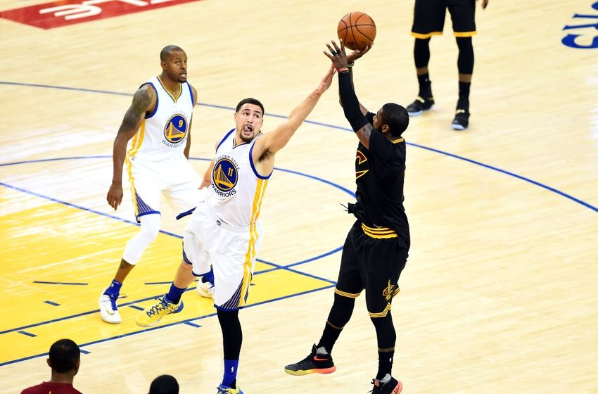 Jun 13, 2016; Oakland, CA, USA; Cleveland Cavaliers guard Kyrie Irving (2) shoots the ball against Golden State Warriors guard Klay Thompson (11) during the second quarter in game five of the NBA Finals at Oracle Arena. Mandatory Credit: Bob Donnan-USA TODAY Sports