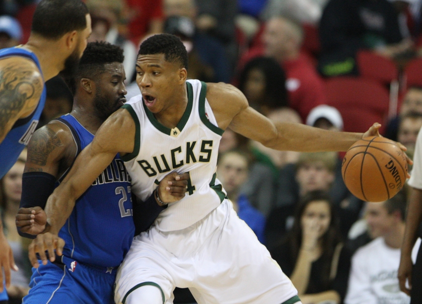 9597292-wesley-matthews-giannis-antetokounmpo-nba-preseason-dallas-mavericks-milwaukee-bucks