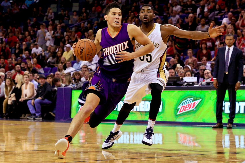 Nov 4, 2016; New Orleans, LA, USA; Phoenix Suns guard Devin Booker (1) drives past New Orleans Pelicans guard E'Twaun Moore (55) during the second half of a game at the Smoothie King Center. The Suns defeated the Pelicans 112-111 in overtime. Mandatory Credit: Derick E. Hingle-USA TODAY Sports