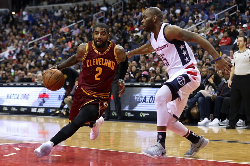 Nov 11, 2016; Washington, DC, USA; Cleveland Cavaliers guard Kyrie Irving (2) dribbles the ball as Washington Wizards guard Marcus Thornton (15) defends in the second quarter at Verizon Center. Mandatory Credit: Geoff Burke-USA TODAY Sports