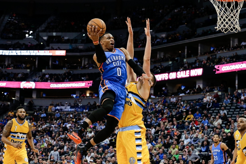 Nov 25, 2016; Denver, CO, USA; Oklahoma City Thunder guard Russell Westbrook (0) shoots over Denver Nuggets forward Nikola Jokic (15) in the fourth quarter at the Pepsi Center. The Thunder won 132-129. Mandatory Credit: Isaiah J. Downing-USA TODAY Sports