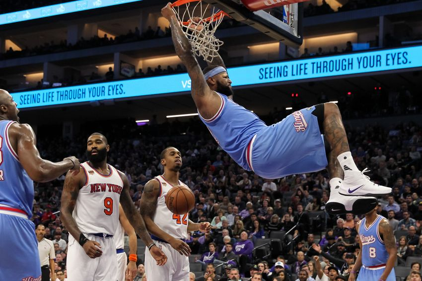 Dec 9, 2016; Sacramento, CA, USA; Sacramento Kings center DeMarcus Cousins (15) dunks the ball past New York Knicks center Kyle O'Quinn (9) during the second half at Golden 1 Center. The Knicks defeated the Kings 103-100. Mandatory Credit: Sergio Estrada-USA TODAY Sports