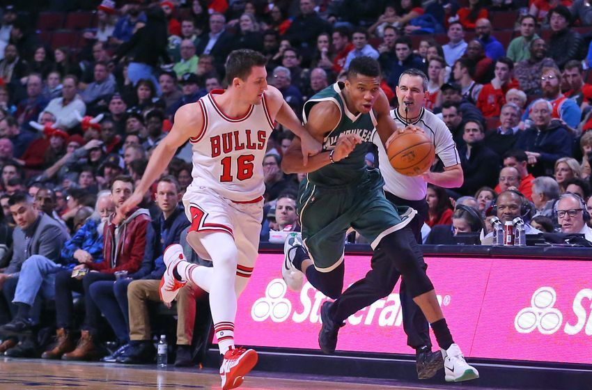 Dec 16, 2016; Chicago, IL, USA; Milwaukee Bucks forward Giannis Antetokounmpo (34) is fouled by Chicago Bulls forward Paul Zipser (16) during the second half at the United Center. Milwaukee won 95-69. Mandatory Credit: Dennis Wierzbicki-USA TODAY Sports