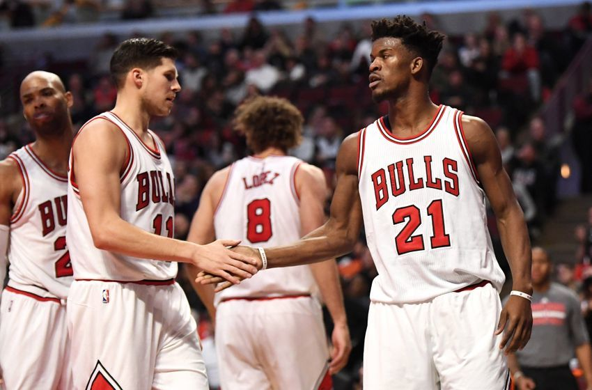 Dec 31, 2016; Chicago, IL, USA; Chicago Bulls guard/forward Jimmy Butler (21) celebrates with teammates during the first half against the Milwaukee Bucks at United Center. Mandatory Credit: Patrick Gorski-USA TODAY Sports
