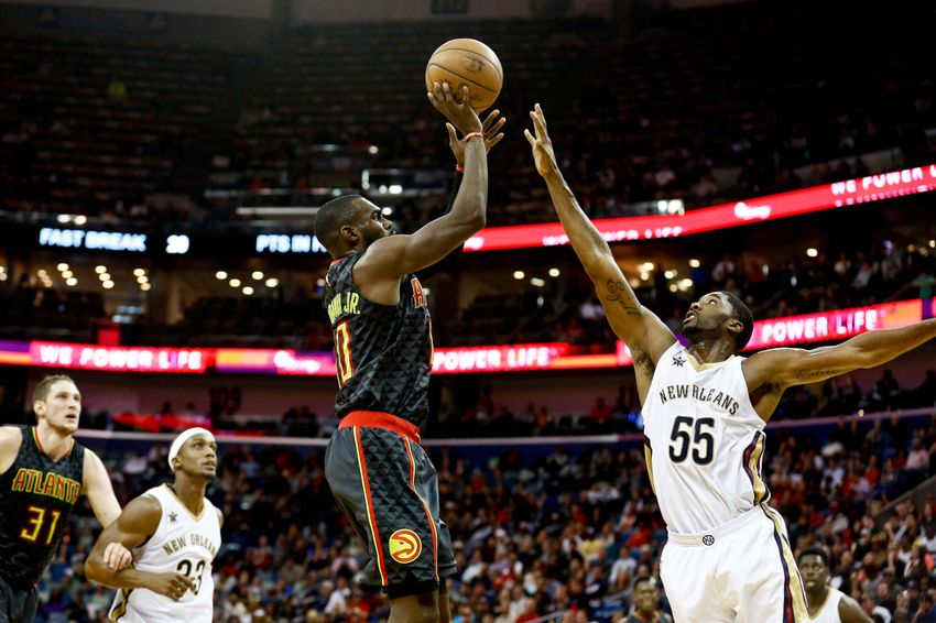 Jan 5, 2017; New Orleans, LA, USA; Atlanta Hawks guard Tim Hardaway Jr. (10) shoots over New Orleans Pelicans guard E'Twaun Moore (55) during the second half of a game at the Smoothie King Center. The Hawks defeated the Pelicans 99-94. Mandatory Credit: Derick E. Hingle-USA TODAY Sports