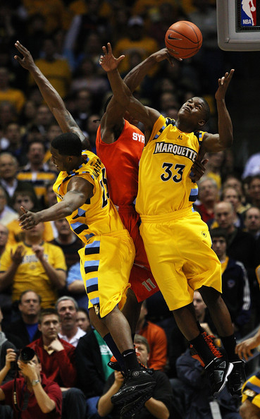 Arinze Onuaku Jimmy Butler #33 and Wesley Matthews #23 of the Marquette Golden Eagles battle for a rebound against Arinze Onuaku #21 of the Syracuse Orange on March 7, 2009 at the Bradley Center in Milwaukee, Wisconsin. Syracuse defeated Marquette 86-79 in overtime. (Photo by Jonathan Daniel/Getty Images) *** Local Caption *** Jimmy Butler;Wesley Matthews;Arinze Onuaku