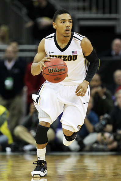 Phil Pressey #1 of the Missouri Tigers controls the ball against the Baylor Bears during the championship game of the 2012 Big 12 Men's Basketball Tournament at Sprint Center on March 10, 2012 in Kansas City, Missouri.
