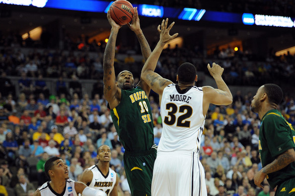 Kyle O'Quinn Kyle O'Quinn #10 of the Norfolk State Spartans attempts a shot against Steve Moore #32 of the Missouri Tigers in the first half during the second round of the 2012 NCAA Men's Basketball Tournament at CenturyLink Center on March 16, 2012 in Omaha, Nebraska.