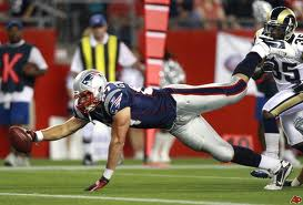 "Rob Gronkowski shows off all of his 6'6"" frame as he stretches for an yard"