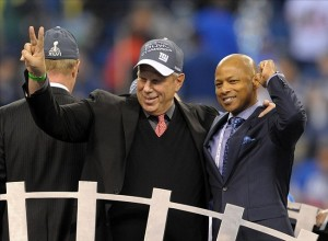 Steve Tisch (left) and general manager Jerry Reese react after Super Bowl XLVI against the New England Patriots at Lucas Oil Stadium. Credit: Kirby Lee of Sport-US PRESSWIRE